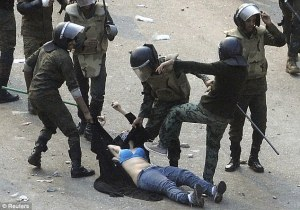 Day of shame in the Middle East: Female protesters beaten with metal poles as vicious soldiers drag girls through streets
